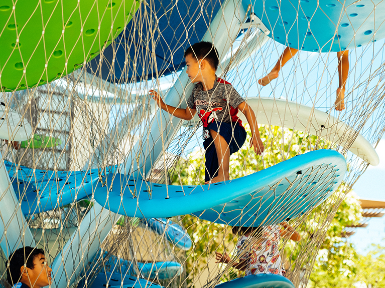 Children playing on the Ala Moana play center structures